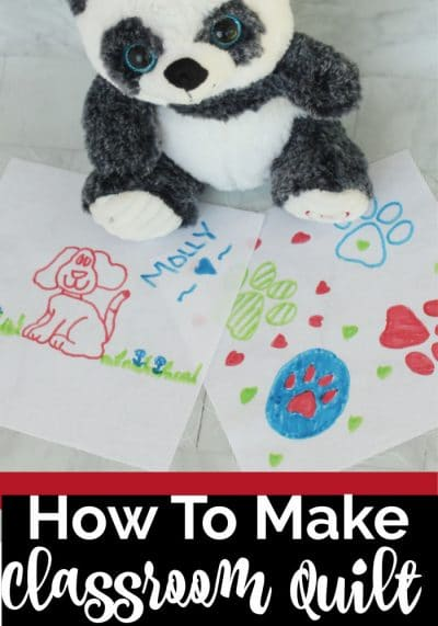 Stuffed panda bear sitting on hand drawn fabric squares. Fabric squares contain dogs drawn with markers in red, blue and green.