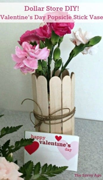 Popsicle stick vase with flowers.