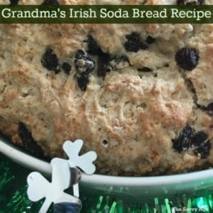 Irish soda bread with raisins in a white dish.