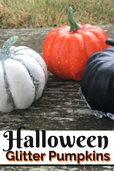 three mini pumpkins decorated with glitter
