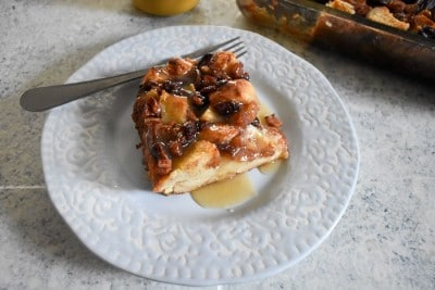 Slice of bread pudding on plate.