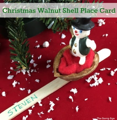Christmas walnut shell place card with snowman