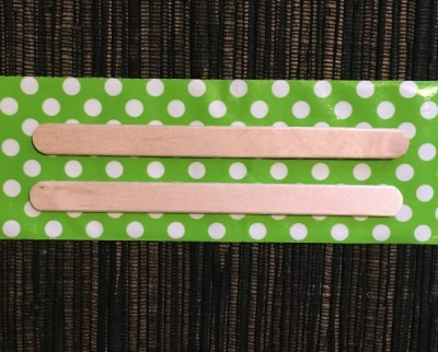 Popsicle sticks on green duct tape.
