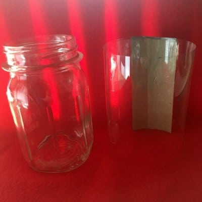 Mason Jar with plastic sleeve.