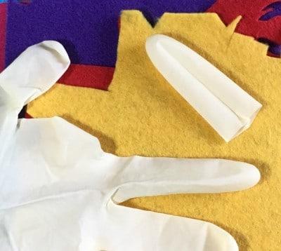 Felt and plastic glove.