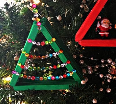 popsicle stick ornament decorated with jewels