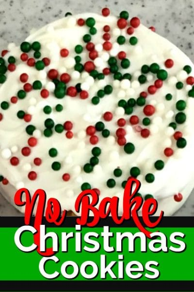 White chocolate covered cookie with red, green sprinkles.