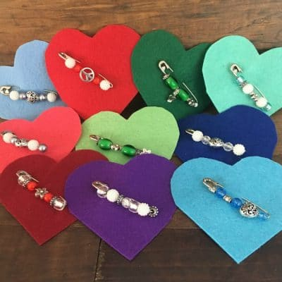 Variety of safety pin broochs on felt hearts
