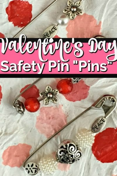 3 brooches made from safety pins and beads: red, pearl, heart beads.