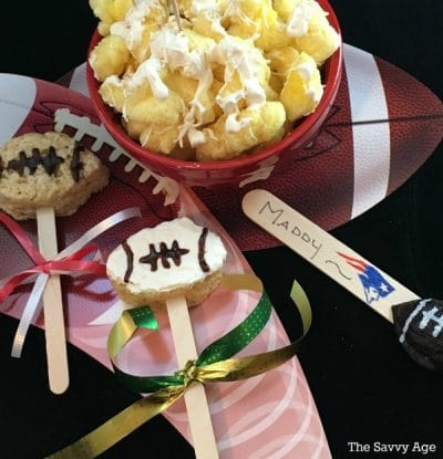 Two Football Lollipops - rice krispie treats shaped footballs on popsicle sticks.