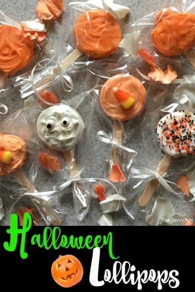 Tray of decorated Halloween lollipops in orange, white and black.