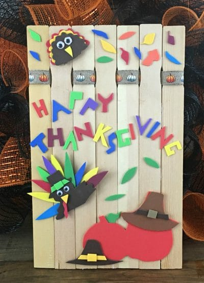 Paint stick turkey craft: paint stick background decorated with paper turkey, owl and leaves.