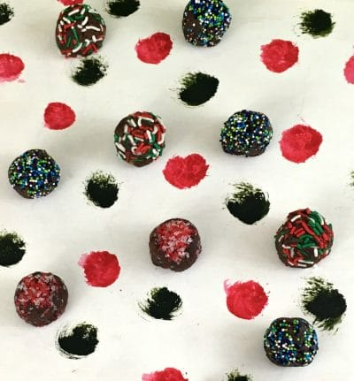 Fudge balls covered with red, green, white sprinkles and jimmies.