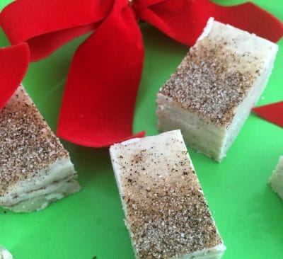 Snickerdoodle fudge squares with a red bow.