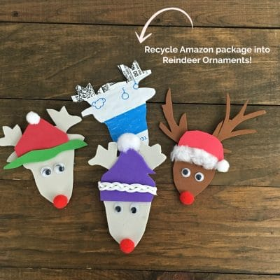 Three reindeer head ornaments made from recycled cardboard.