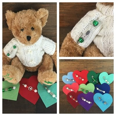 Teddy Bear in Irish sweater with pin made from a safety pin and green beads.