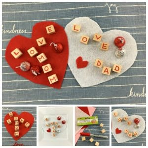 Homemade red hearts with wood blocks spelling I Love mom and I Love Dad sprinkled with red and silver Hershey kisses.