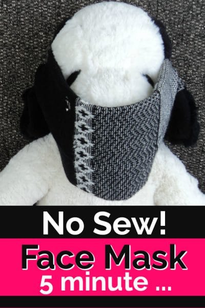 Stuffed Snoopy with a face mask made of a sock.