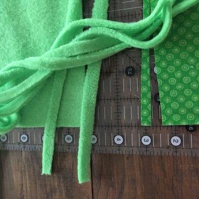 Green fleece cut into ties.