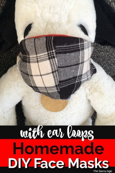 Stuffed Snoopy wearing a homemade plaid face mask.