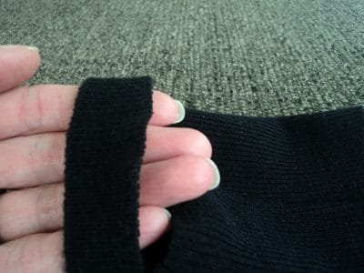 Black sock with 1 onch slit and fingers poking through the slit.