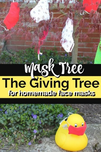 Red Japanese maple with homemade face masks hanging off tree branches.