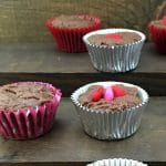 Fudge cups in silver cupcake liners with red heart decorations on top.